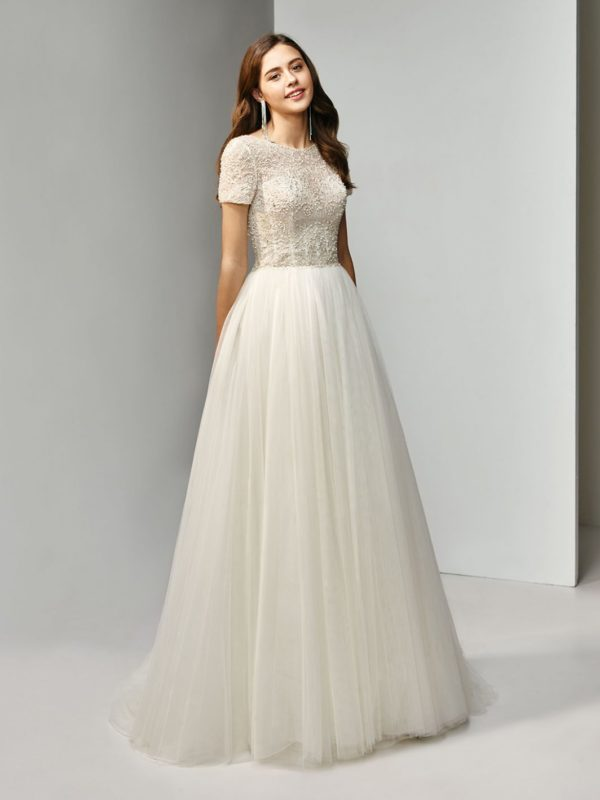 763aadb0a2540 At The O Zone discover a diverse collection of beautiful designer wedding  gowns from simple classic elegance, fun and funky, or glamour and sparkle  at ...